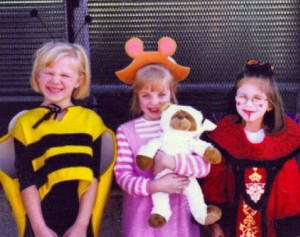 Here I am in kindergarten with my friends Rachel and Gina. As you can see, they were cute things like a bumblebee and DW from Arthur. There I am as Queen Amadala. It was the end of the day so I took off the fantastical crown.
